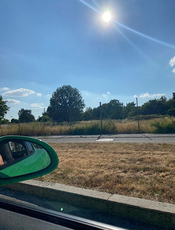 Foto aus dem Auto gegen die Sonne fotografiert 1